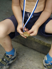 A boy with a gold medal, Sweden.