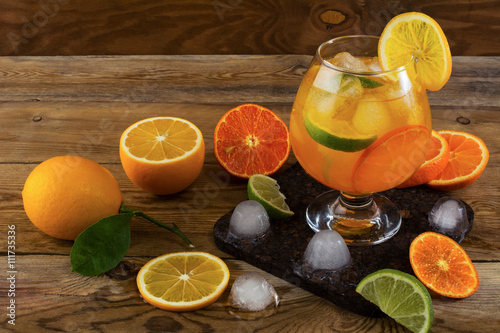 "Tropical fruit cocktail with ice on wooden table"" Imagens e fotos de ..."