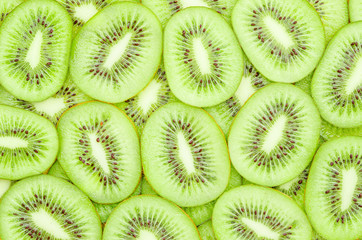 Many slices of kiwi fruit.