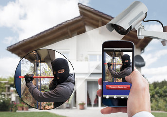 Person Hand Holding Mobile Phone Detecting Burglar
