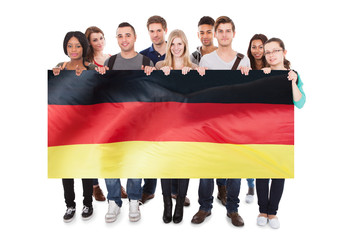 Young People Holding German Flag
