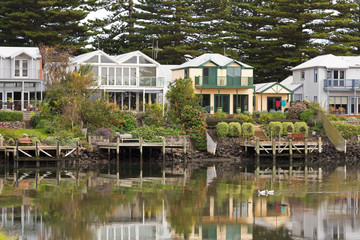 Beautiful modern waterfront houses along the Moyne River in Port Fairy, Victoria, Australia.