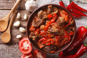lamb cooked with onion, tomato and pepper closeup. horizontal top view