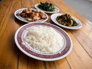 Thai food meal , crispt pork , fried vegetable , rice , spicy ch