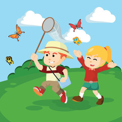 boy an girl catching butterflies togther
