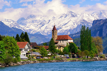 Brienz town near Interlaken and snow covered Alps mountains, Switzerland Wall mural