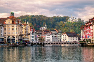 Old town of Lucerne reflecting in Reuss River, Switzerland
