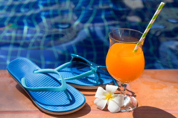 Orange mango fresh juice smoothie drink cocktail slippers and su