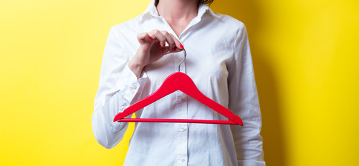 young woman with hanger