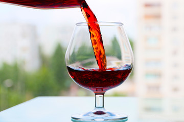 fine patterns present red wine into a glass