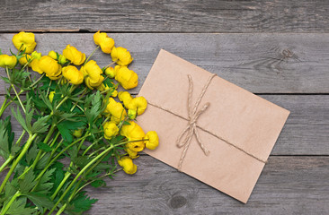 Yellow flowers on a wooden background