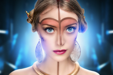 young beautiful girl, model, woman, princess, character, alien. Fabulous, mystical look. Bright, creative, fantasy makeup, futurism style, gold, brown forehead, lines, pattern, nose, neck, pink lips.