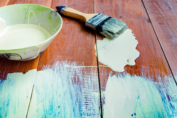 Paint brush and  bowl  of white coating color