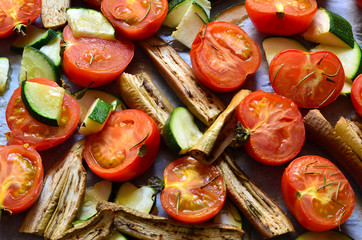Vegetables roasted with rosemary,garlic and olive oil. Includes tomatoes , white aubergine  and zucchini.Healthy eating.