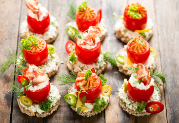 Canapes with stuffed cherry tomatoes
