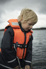 Portrait of a boy in a life vest.