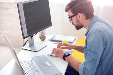 Man writing codes on computer