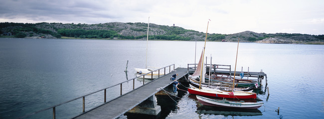 Boats moore to a jetty.