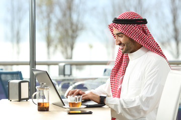 Arab saudi man working online with a laptop