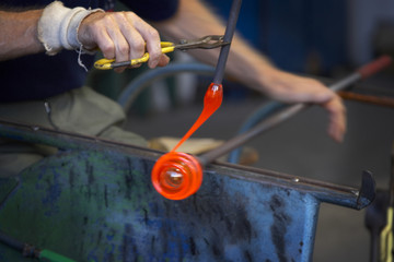 Blowing glass in a glasswork.