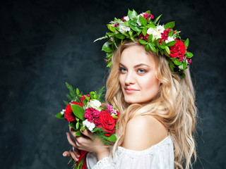 beautiful blonde girl in a wreath of flowers