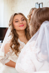 Closeup portrait of young beautiful bride in her wedding day
