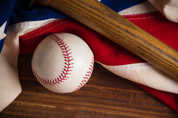 Baseball, bat on a wooden background