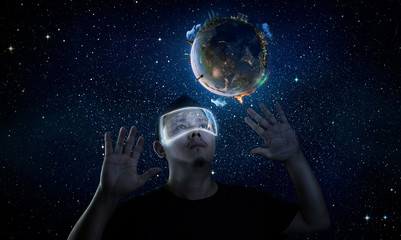 Man wearing futuristic virtual reality glasses . Elements of this image furnished by NASA.