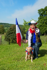 French Soccer fan with dog and megaphone