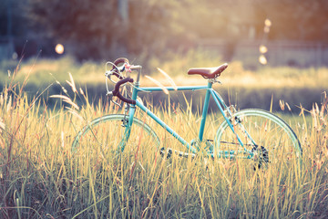 beautiful landscape image with sport vintage Bicycle at sunset ;