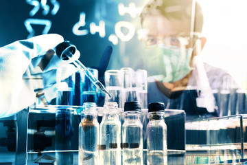 Laboratory research, dropping chemical liquid to test tubes