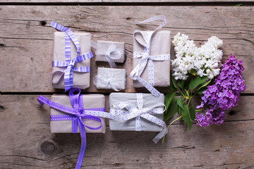 Wrapped  gift boxes with presents  and lilac flowers