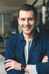 Cheerful guy is expressing positive emotions