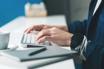 Skillful male freelancer is working on computer