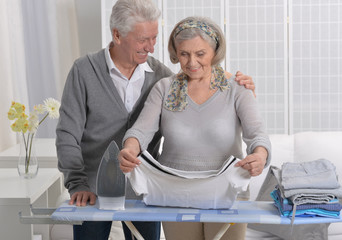 happy Senior couple ironing