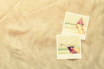 top view of instant photos album on sand background