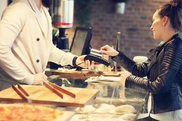 Woman paying in restaurant