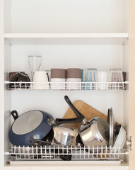 wet dishes in the dish draining closet