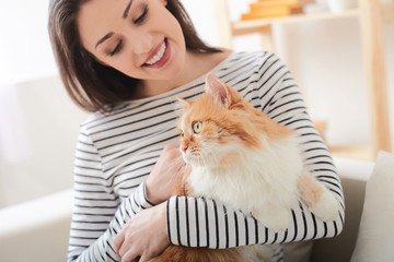 Cheerful young woman is relaxing with animal