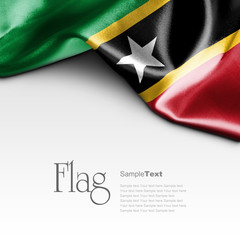 Flag of Saint Kitts and Nevis on white background. Sample text.