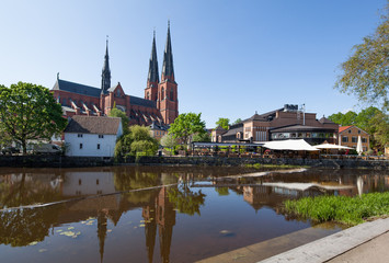 Uppsala Church with its reflection on the river.