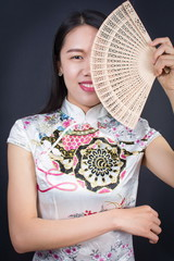 Beautiful Asian woman with a hand fan