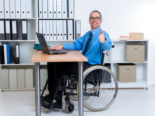 disabled business man with thumb up