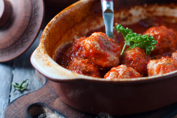 Meatballs in sweet and sour tomato sauce.