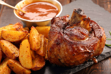 Grilled barbecue meat with baked potato and dip