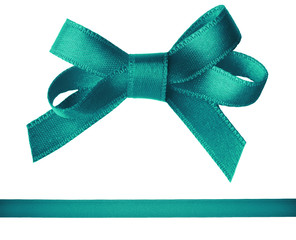 Green satin bow and ribbon isolated on white
