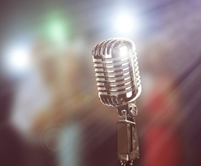 Retro silver microphone on blurred background