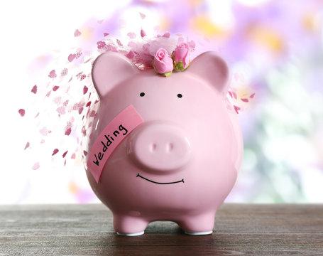 Piggy bank with wedding veil blurred festive background