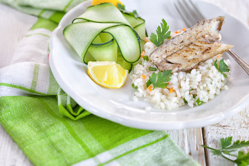 Grilled fillet of herring with rice