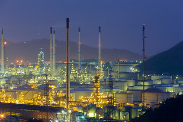 Night, aerial view automative refinery with mountain background